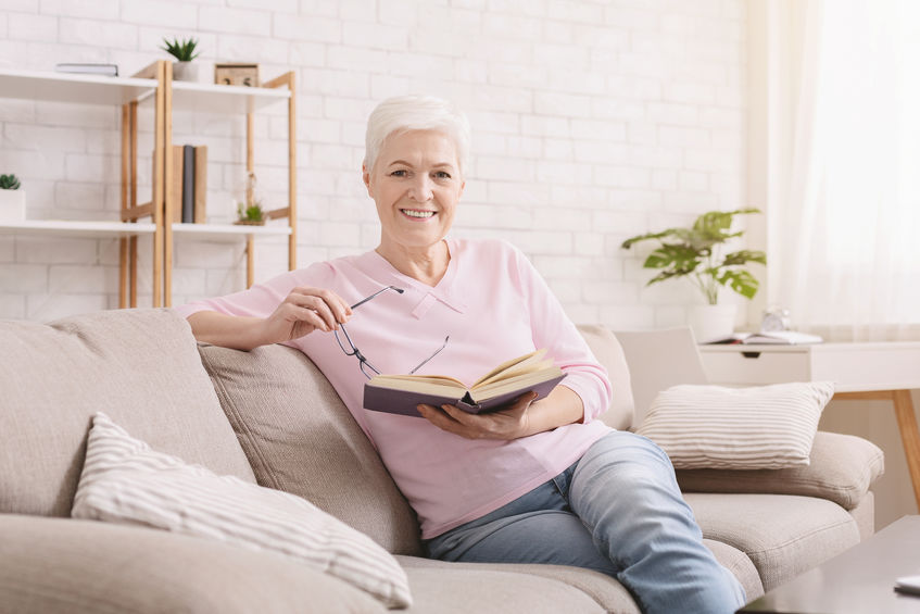 """Cheerful senior woman reading educational book at home - 3 Natural Brain-Boosters that Rival Trendy """"Smart Drugs"""""""