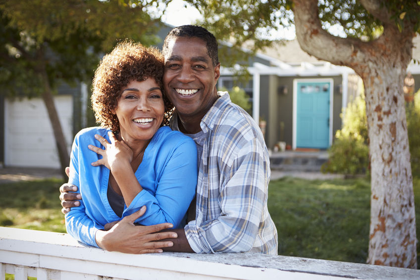 Portrait Of Mature Couple Looking Over Back Yard Fence - Reduce Stress Naturally with Pregnenolone