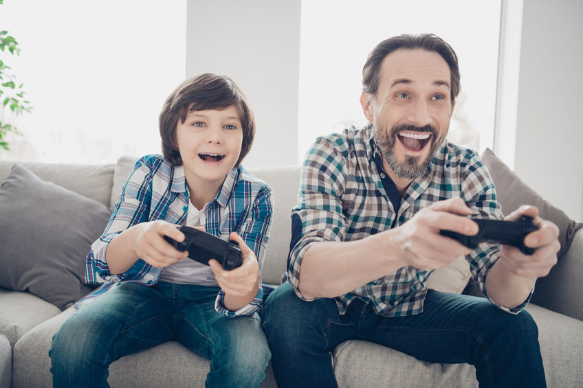 Older family member and child playing video games together - The #1 Nutrient for Optimal Brain Function: ATP