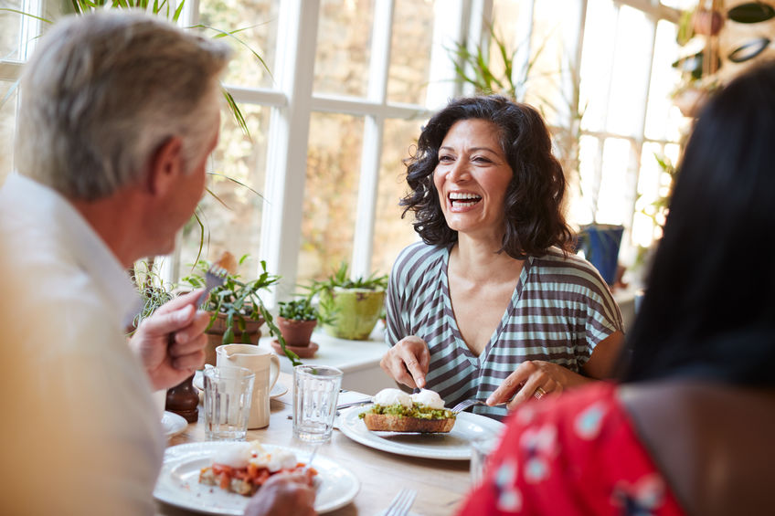 Laughing woman laughing with male friend at a cafe, close up - Beat Menopausal Symptoms with Maca Root
