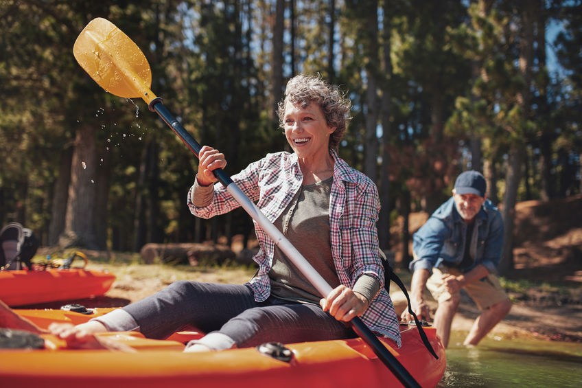 Mature couple enjoying a day at the lake with kayaking - 8 Powerful, Natural Substances that Boost Vitality and Happiness