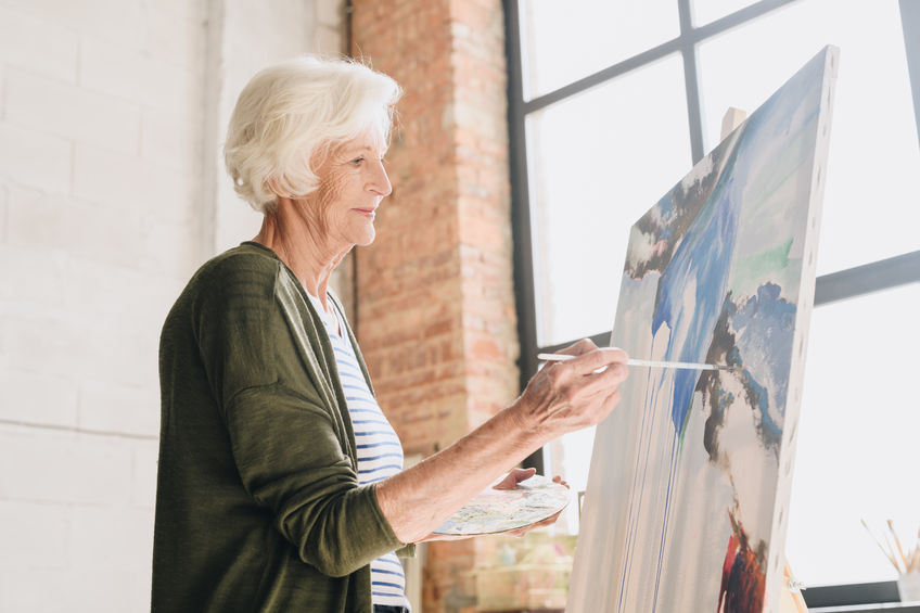 Talented Senior Woman Painting in Art Studio - Reduce Arthritis and Inflammation Symptoms Naturally