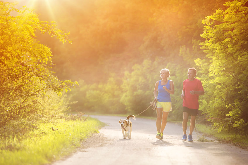 Senior couple running - natural energy without coffee