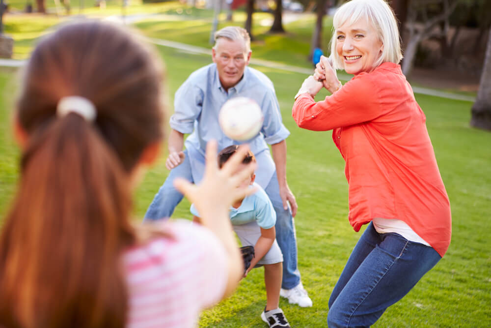 Grandparents playing baseball with grandkids - 3 Sources of Inflammation-Busting, Natural Healing Everyone Needs