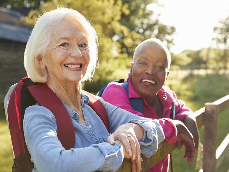 Portrait Of Two Senior Friends Hiking In Countryside - How D-Ribose Can Greatly Improve Your Heart Health