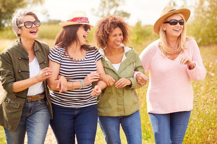 Group Of Mature Female Friends Walking Along Path Through Campsite - Maca Root: Your Secret Weapon Against Menopause