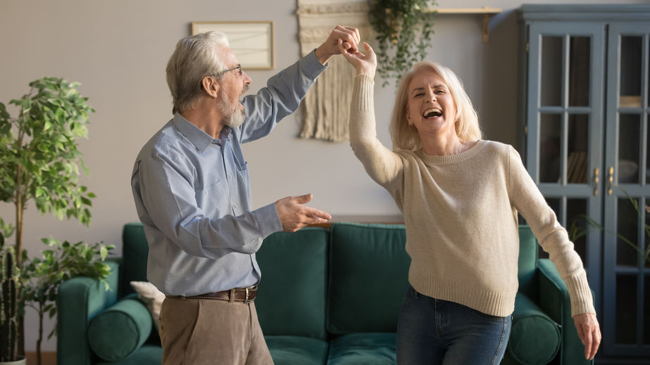 Joyful active mature couple dancing in living room - D-Ribose: The Ultimate Natural Energy Booster