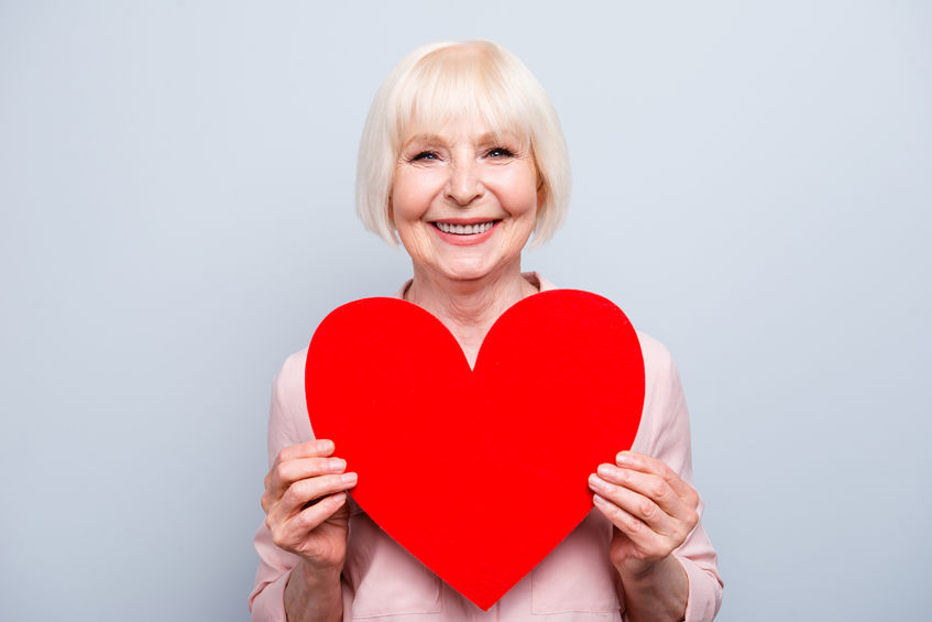Portrait of mature blonde happy lady holding a paper heart - Could DMG Be Even Better for the Heart than CoQ10?