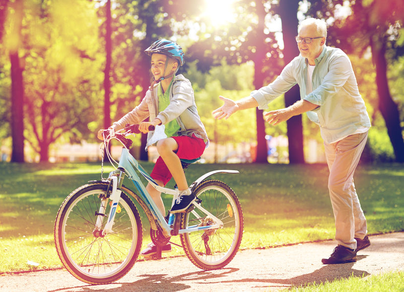 grandfather and boy with bicycle at summer park – Fight Back Against Premature Aging with Pregnenolone