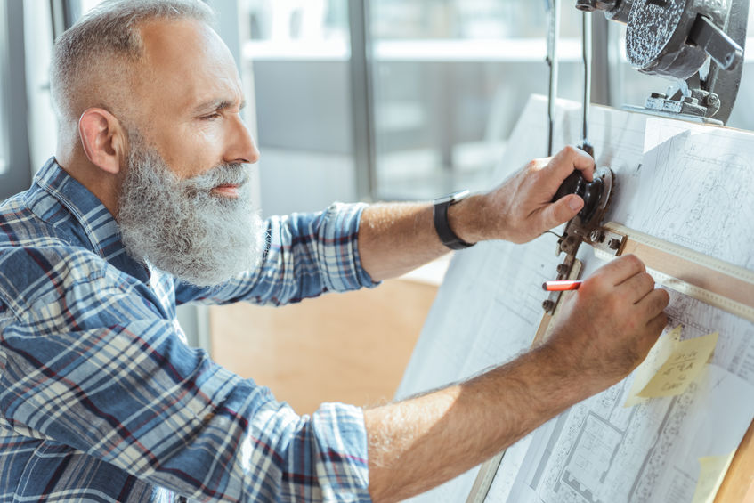 Pleasant serious older man is working on professional board - Five Crucial Resources for Optimal Cognitive Function