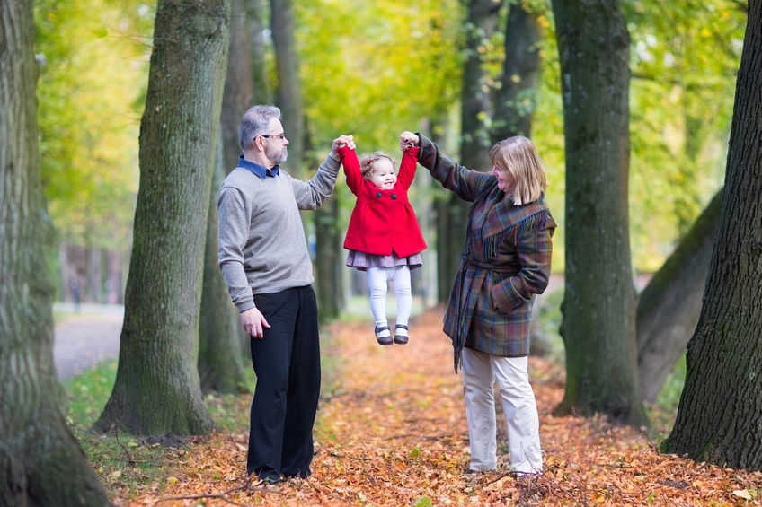 Happy family playing with a little toddler girl in an autumn park - Powerful, Natural Energy All Day with Maca Root!