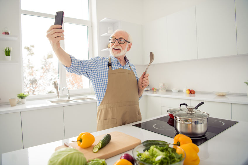 "Close up photo grey haired he his him grandpa hands telephone smart phone make take pictures process cooking relatives children wear specs casual checkered plaid shirt jeans denim outfit kitchen - Fight Back Against So-Called ""Senior Moments""!"