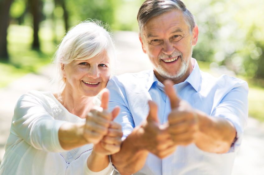 A happy, mature couple giving thumbs up - Lift Your Spirits Naturally, Every Morning!