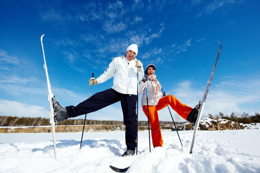 happy mature couple posing in front of camera while skiing - Natural Joint Healing So You Can Do the Things You Love!