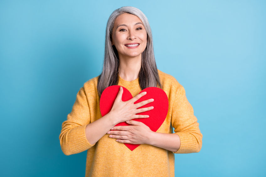 Photo of attractive mature woman white grey hairdo hands hold hug paper red heart - Take Care of Your Heart…Naturally!