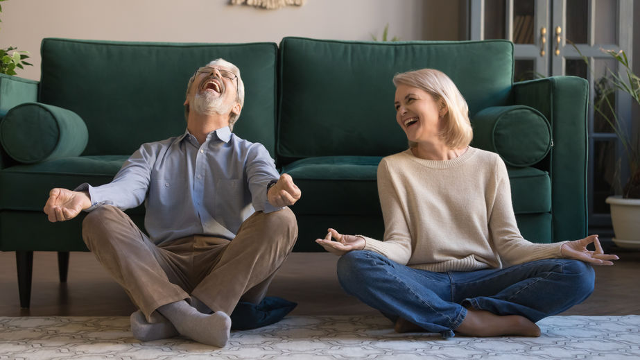 Laughing spouses sitting on floor in lotus position - Vitamin B12: The Last Antidepressant You'll Ever Need?