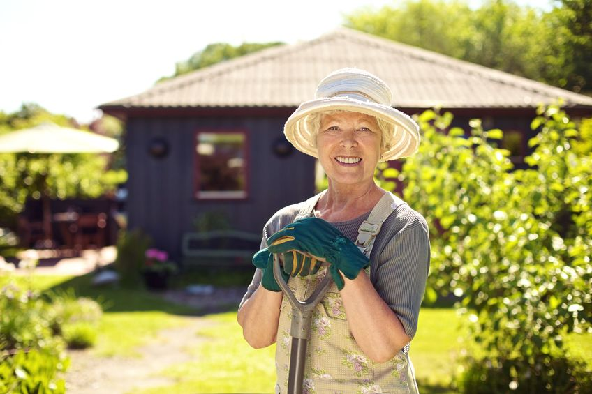 Cheerful elder woman with gardening tool in backyard - Can You Really Stay Healthy, Vital and Strong as You Age?