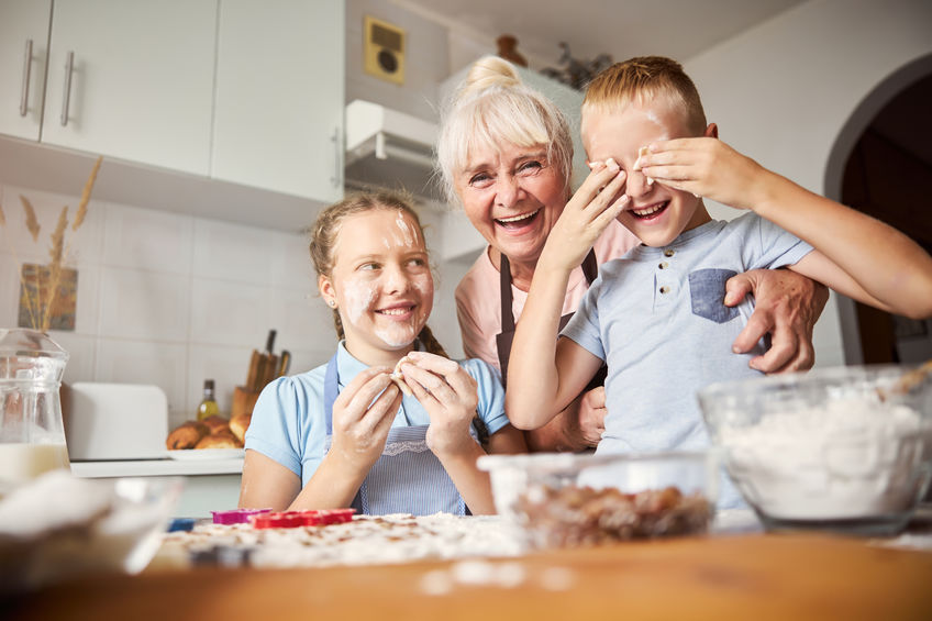 Family portrait of grandma and grandchildren during cookie-making - How Boron Can Help Fight the Ravages of Arthritis