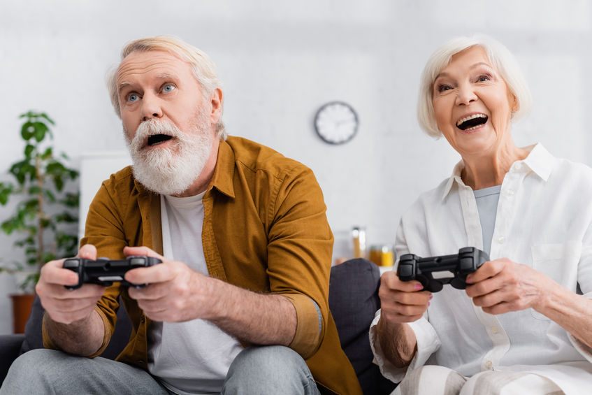 Excited senior couple playing video game together - Keeping a Sharp, Youthful, Quick Mind as You Age