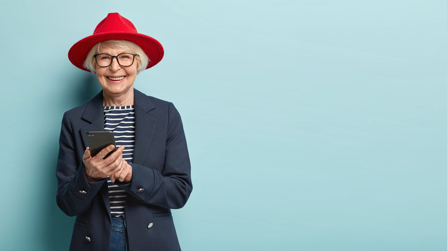 Overjoyed senior lady in stylish apparel and hat - Natural Energy that Boosts Heart Health!