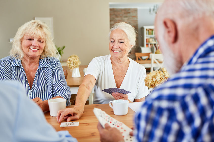 Group of seniors playing cards - A Natural Way to Boost Your Memory and Focus!