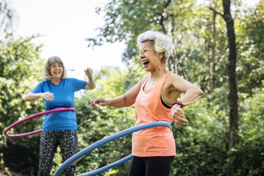 Senior women exercising with a hula hoop - How to Boost Your Energy…from the Cellular Level Up!