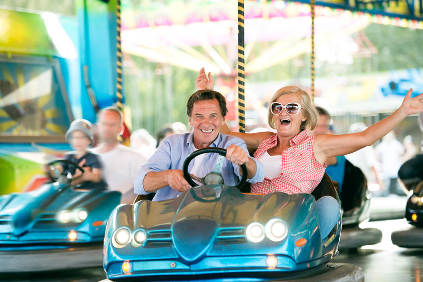 Senior couple in the bumper car at the fun fair - 6 Clinically-Proven Nutrients for Joint Pain Relief!