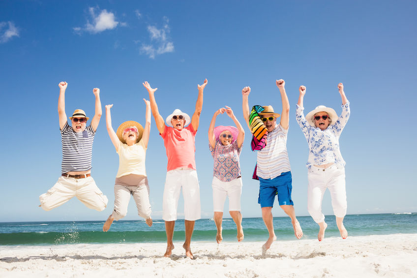 Happy senior friends jumping on the beach - Lasting Natural Energy and Stamina from a Humble Plant!