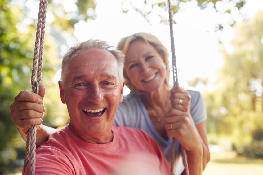 Portrait Of Retired Couple Having Fun With Woman Pushing Man On Garden Swing - Restore Your Natural Hormone Balance to Fight Premature Aging!